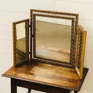 A gilt dressing table mirror