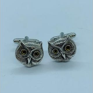 A pair of silver owl shaped cufflinks