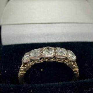 An 18ct yellow gold five stone old cut diamonds of 1ct approx.