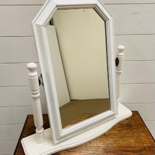 A white dressing table mirror
