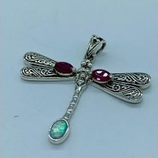 A silver dragon fly pendant necklace set with ruby cabochons and opal