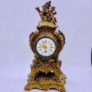 A Gilt Mantle Clock