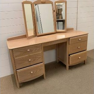 A lime oak dressing table and mirror