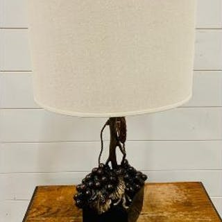 A Bronze Grape and vine themed lamp on a slate base with attendance shade.