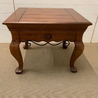 A square low table with metal ware detail to side (H59cm D61cm W71cm)