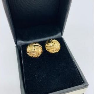 A pair of yellow gold earrings in the form of knots