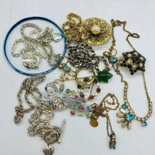 A small volume of Vintage and silver costume jewellery.