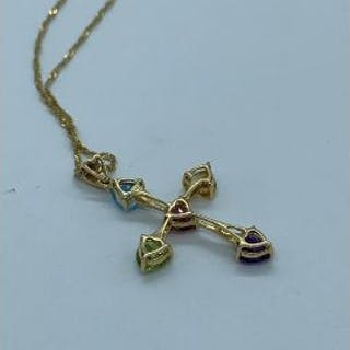 A pendant in cross form with semi precious stones to include aquamarine