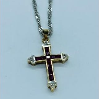 A ruby and diamond cross in a 9ct setting on a 9ct chain