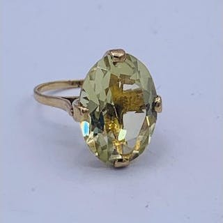 A Cocktail ring in 9ct gold with A central Citrine stone.