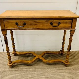 A pine console table with cross band stretcher