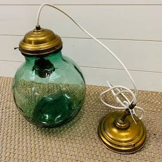 A converted viresa green glass carboy celling lamp with antique brass
