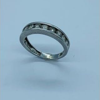 A Platinum and diamond half eternity ring.