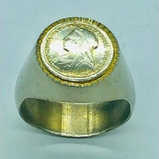 A Signet ring with a Victorian mounted coin, white metal.