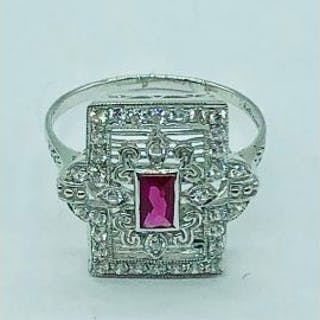 A silver and cz art deco style ring with central ruby panel