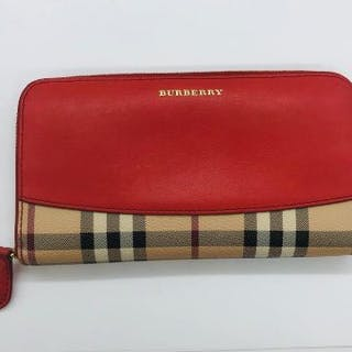 A Burberry purse/wallet with contrasting orange leather