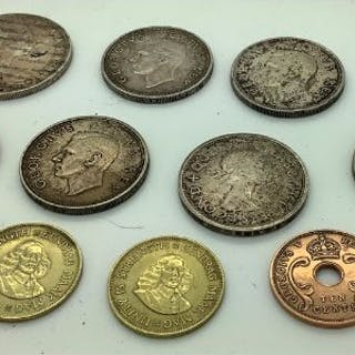 Coins to include South African 5 shillings, two Southern Rhodes, a