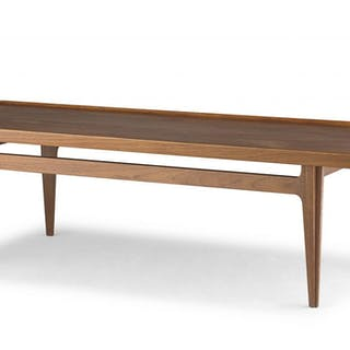 A Danish teak coffee table designed in the 1960s by Finn Juhl for