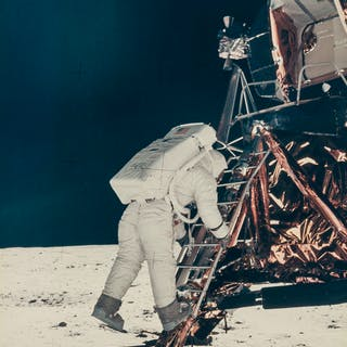 Armstrong (Neil) Buzz Aldrin steps off the lunar module ladder onto