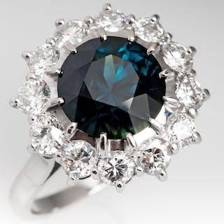 Dark Blue Green Sapphire & Diamond Halo Ring in Platinum