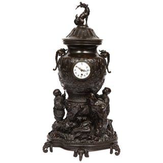 A Japanese Patinated Bronze Figural Clock Vase, Meiji Period
