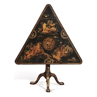 A CHINESE EXPORT BLACK AND GOLD LACQUERED TRIANGULAR TILT-TOP GAMES