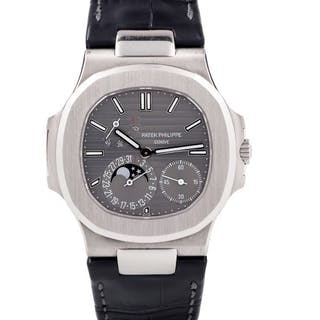 PATEK PHILLIPE | NAUTILUS, REF 5712 WHITE GOLD WRISTWATCH WITH DATE
