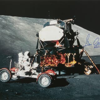[APOLLO 17]. EXPLORING TAURUS LITTROW. COLOR PHOTOGRAPH, SIGNED AND