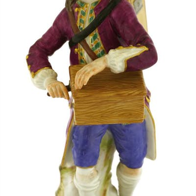 A Meissen porcelain figure of an hurdy-gurdy player