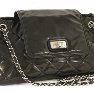 46673d6f08c1 A Chanel black patent leather re-issue Accordion flap handbag