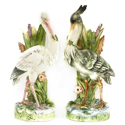 A pair of majolica pottery stick stands