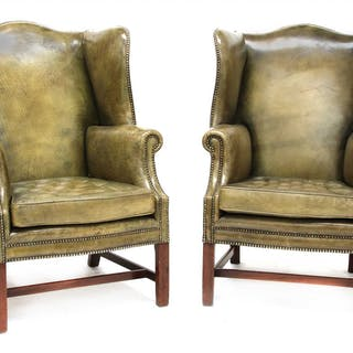 A pair of George III-style wing armchairs