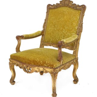 A French giltwood open armchair