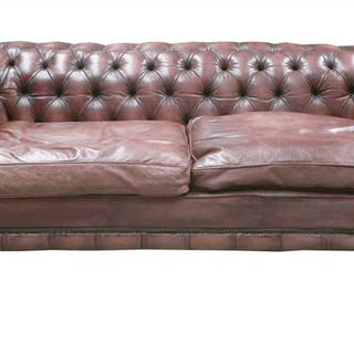 A modern leather three-seater chesterfield settee