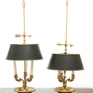 A pair of brass three-light table lamps