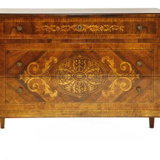 An Italian walnut and inlaid commode chest