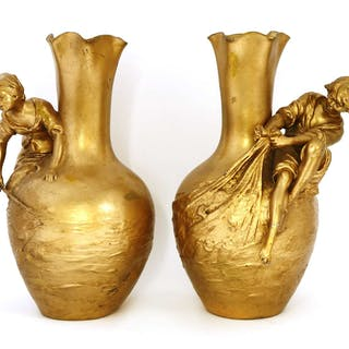 A pair of gilt metal baluster vases