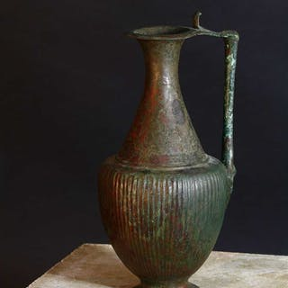 A Persian bronze ewer