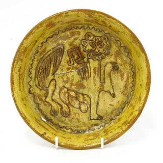 A Fustat Fatimid yellow-glazed sgraffito dish