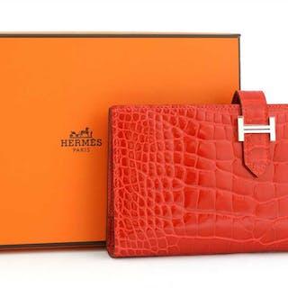 An Hermès red alligator skin wallet