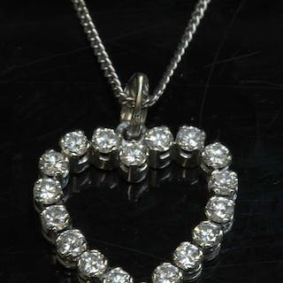 A white gold diamond set heart-shaped pendant and chain