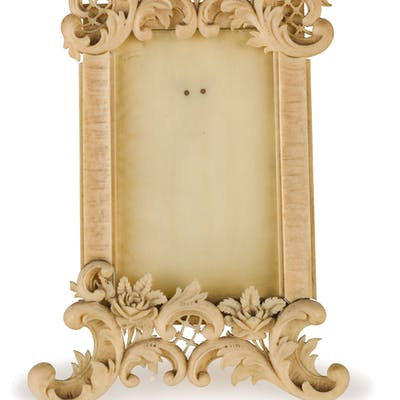 A SMALL CARVED IVORY FRAME, LATE 19TH CENTURY; WEAR, FEW CHIPS AND
