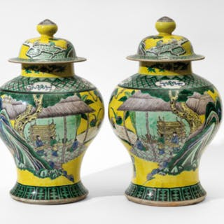 A PAIR OF YELLOW-GROUND 'FAMILLE VERTE' PORCELAIN POTICHES AND COVERS