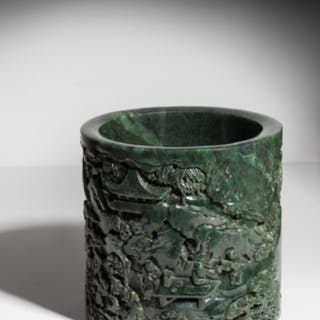A HIGHLY IMPORTANT AND FINELY CARVED LARGE SPINACH-GREEN JADE 'SCHOLAR'