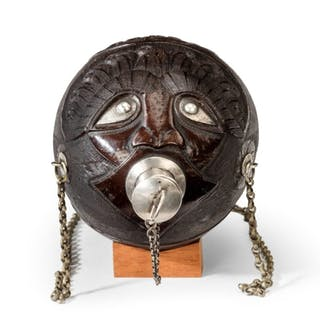 """A superb coconut shell """"bugbear"""" powder flask with silver mounts and"""