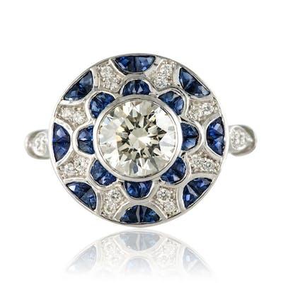 Bague ronde saphirs calibrés et diamants