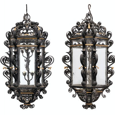 A PAIR OF GERMAN PATINATED AND PARCEL-GILT WROUGHT AND CAST-... EARLY