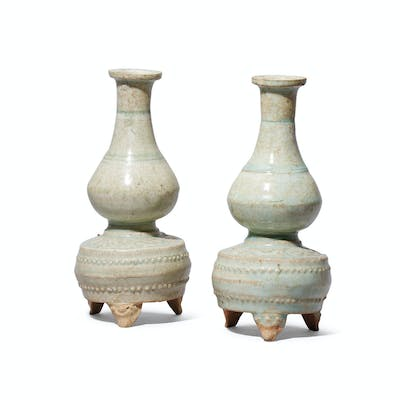 A PAIR OF QINGBAI MOULDED TRIPOD VASES SOUTHERN SONG-YUAN DYNASTY (112...
