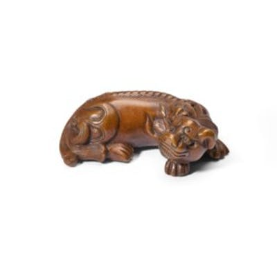 A CAST BRONZE LION-FORM WEIGHT
