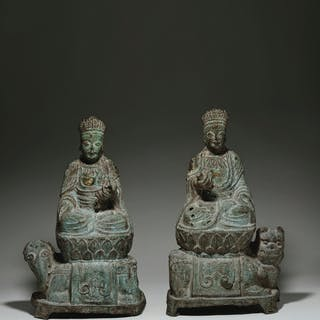 A PAIR OF LARGE CAST-IRON FIGURES OF THE BODHISATTVAS MANJUS... KANGXI